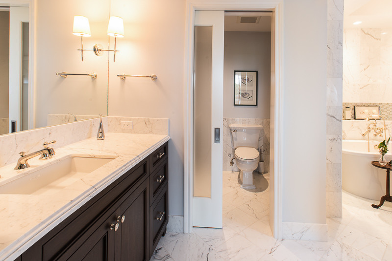 Inspiration for a large transitional master gray tile, white tile and marble tile marble floor and white floor bathroom remodel in Houston with beaded inset cabinets, dark wood cabinets, white walls, an undermount sink, marble countertops and a hinged shower door