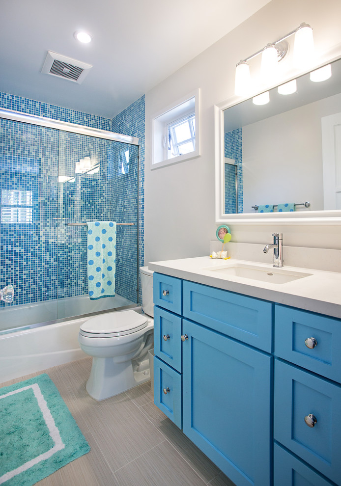 Inspiration for a mid-sized timeless kids' blue tile and mosaic tile porcelain tile and gray floor bathroom remodel in Los Angeles with an undermount sink, shaker cabinets, blue cabinets, quartz countertops, beige walls, a two-piece toilet and gray countertops