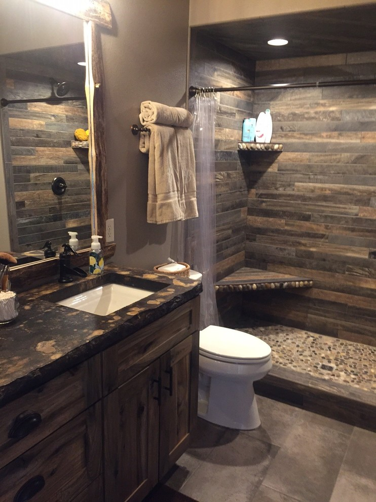 Doorless shower - small rustic master multicolored tile and porcelain tile porcelain tile and gray floor doorless shower idea in Other with shaker cabinets, medium tone wood cabinets, brown walls and concrete countertops