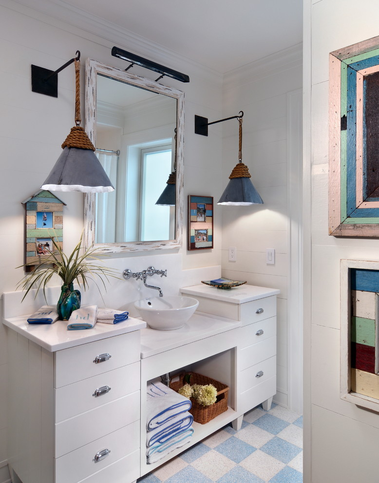 Example of a beach style bathroom design in Jacksonville with a vessel sink, flat-panel cabinets, white cabinets and white walls
