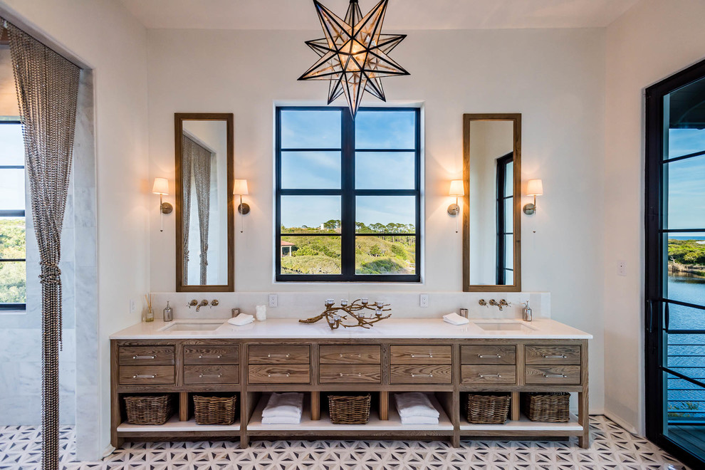 Example of a tuscan multicolored floor and cement tile floor doorless shower design in Miami with furniture-like cabinets, dark wood cabinets, white walls, an undermount sink, solid surface countertops and white countertops