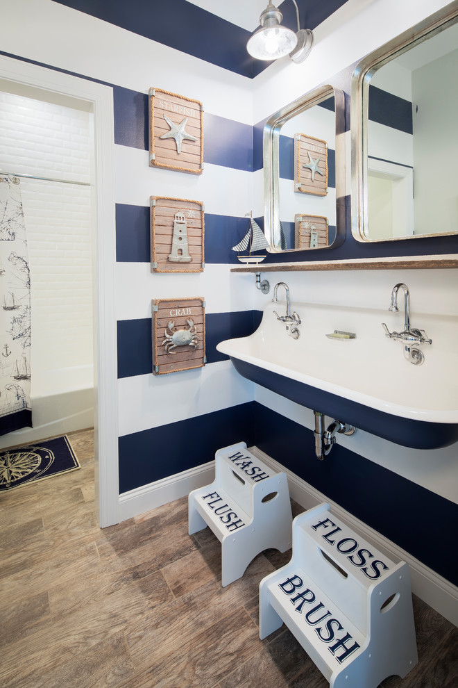 Example of a beach style kids' brown floor bathroom design in New York with a trough sink and multicolored walls