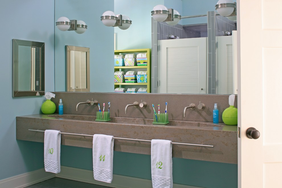 Beach style kids' gray tile bathroom photo in Grand Rapids with a trough sink, concrete countertops and blue walls