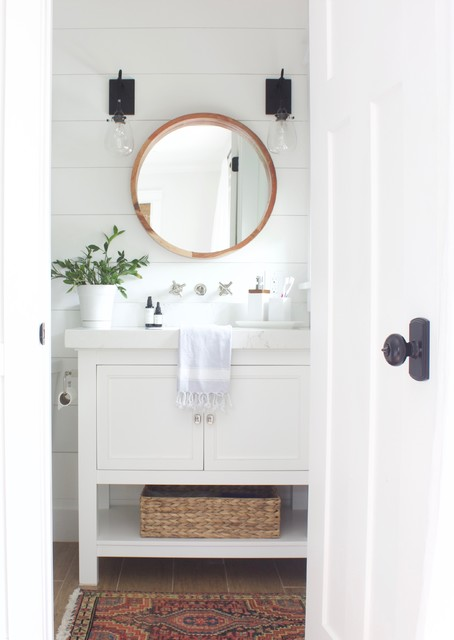 Design ideas for a small nautical ensuite bathroom in Orlando with shaker cabinets, white cabinets, an alcove shower, a one-piece toilet, white walls, ceramic flooring, engineered stone worktops, brown floors and a shower curtain.
