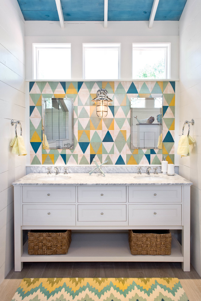 Mid-sized beach style bathroom photo in Austin with furniture-like cabinets, white cabinets, multicolored walls and an undermount sink