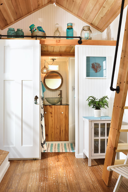 Inspiration for a small beach style corner shower remodel in Portland with white walls and a