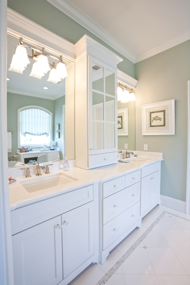 Inspiration for a large coastal 3/4 white tile and porcelain tile porcelain tile bathroom remodel in Houston with an undermount sink, shaker cabinets, white cabinets and green walls