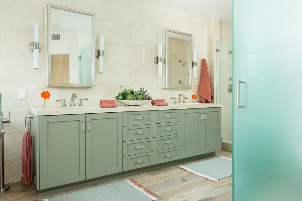 Bathroom - large coastal master beige tile and marble tile light wood floor and gray floor bathroom idea in Los Angeles with shaker cabinets, green cabinets, a bidet, beige walls, a drop-in sink, marble countertops and a hinged shower door