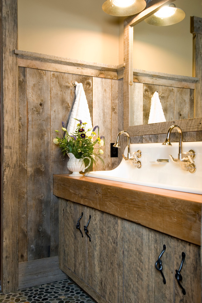 Mountain style bathroom photo in Other with a trough sink, flat-panel cabinets and distressed cabinets