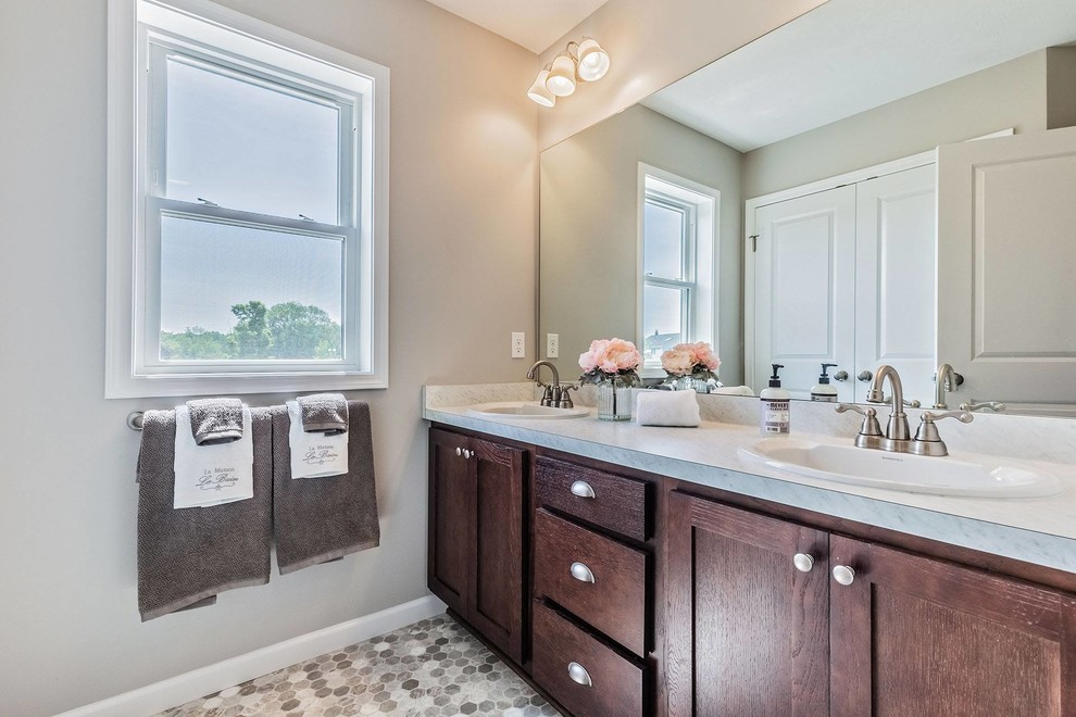 Large cottage kids' cement tile floor and multicolored floor bathroom photo in New York with shaker cabinets, dark wood cabinets, a one-piece toilet, gray walls, an undermount sink, granite countertops and gray countertops