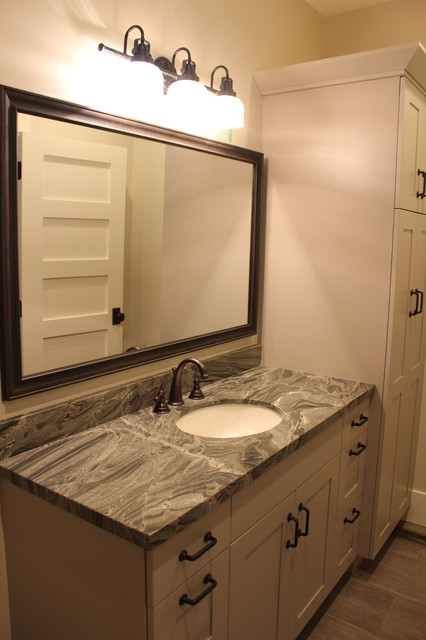 Inspiration for a large transitional master gray tile and porcelain tile doorless shower remodel in Salt Lake City with shaker cabinets, gray cabinets, gray walls, an undermount sink and a two-piece toilet