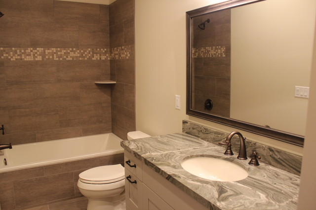 Large transitional master gray tile and porcelain tile doorless shower photo in Salt Lake City with shaker cabinets, gray cabinets, gray walls, an undermount sink and a two-piece toilet