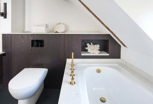 Design ideas for a small contemporary bathroom in Sussex with flat-panel cabinets, brown cabinets, a corner bath, a wall mounted toilet, white walls and black floors.