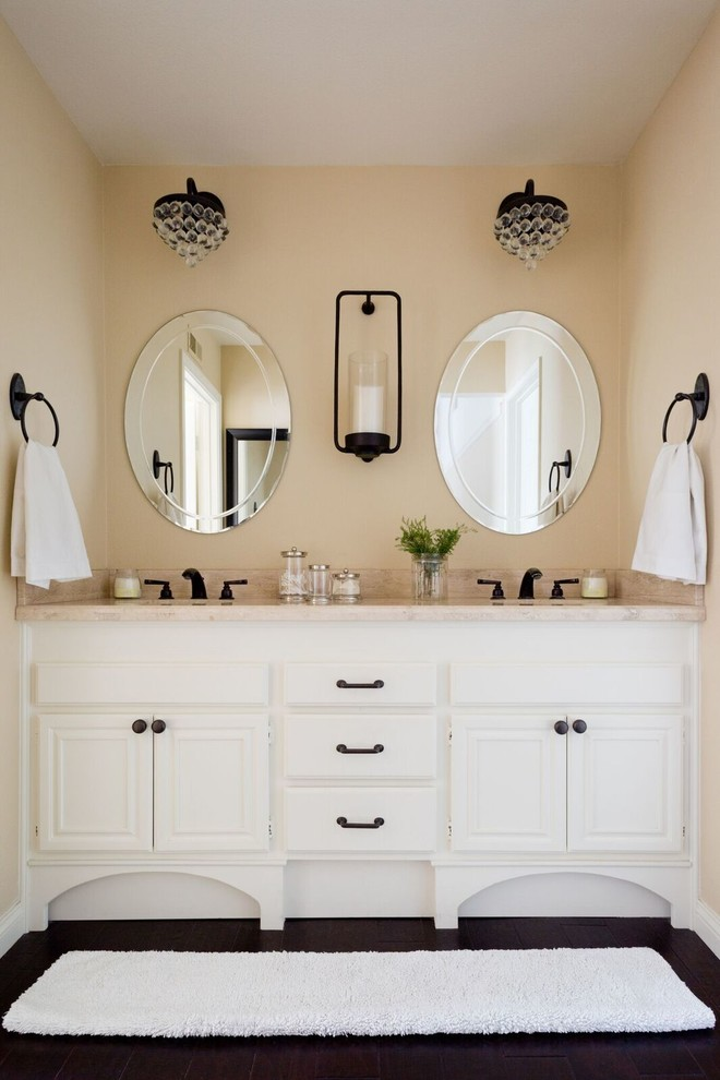 Bathroom - mid-sized traditional master dark wood floor bathroom idea in Los Angeles with recessed-panel cabinets, white cabinets, beige walls, granite countertops and an undermount sink