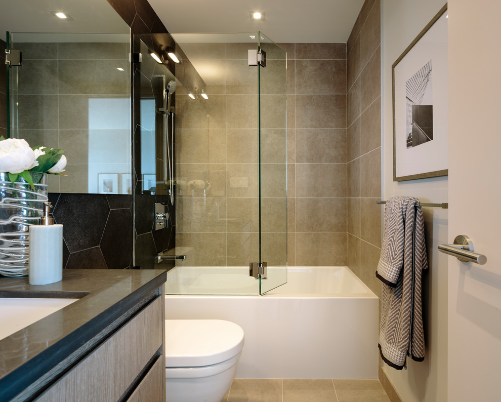 Example of a large trendy master beige tile and porcelain tile porcelain tile and beige floor bathroom design in Vancouver with flat-panel cabinets, medium tone wood cabinets, a wall-mount toilet, beige walls, a vessel sink, quartz countertops, a hinged shower door and gray countertops