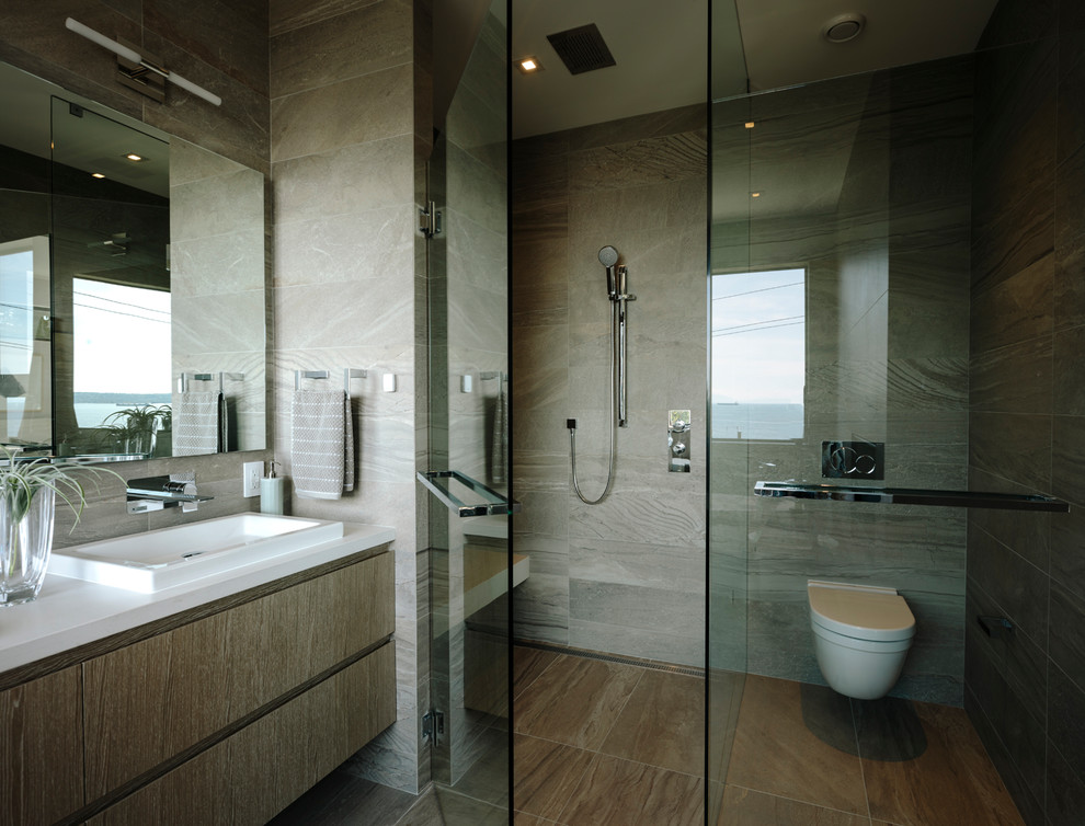 Example of a large trendy master gray tile and porcelain tile porcelain floor and gray floor bathroom design in Vancouver with flat-panel cabinets, medium tone wood cabinets, a wall-mount toilet, gray walls, a vessel sink, quartz countertops, a hinged shower door and white countertops