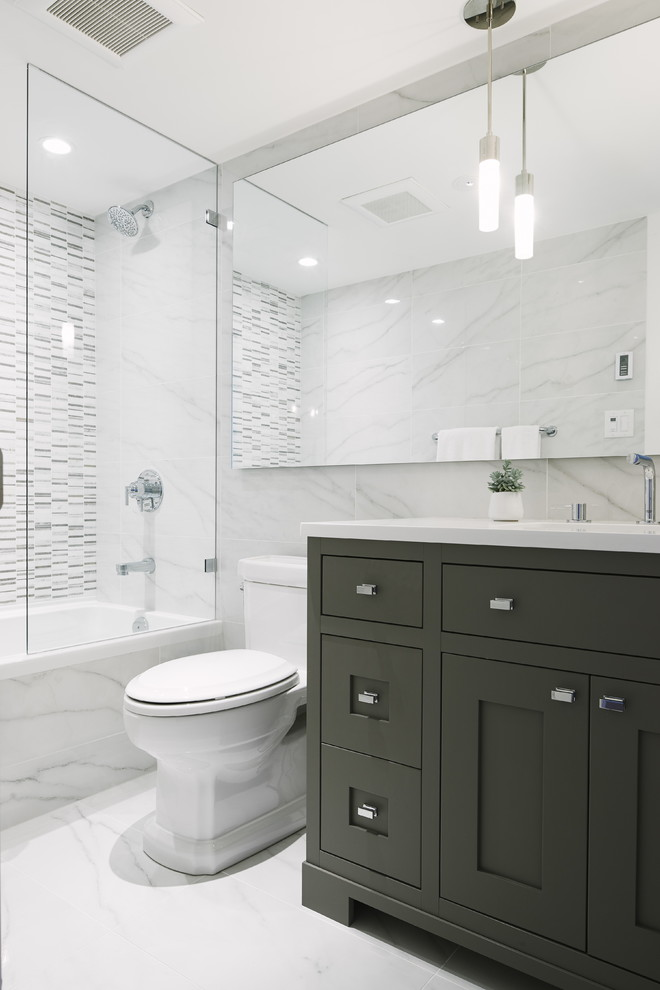 Bathroom - mid-sized transitional master porcelain tile and white tile porcelain floor bathroom idea in Vancouver with shaker cabinets, gray cabinets, white walls, quartz countertops and an undermount sink