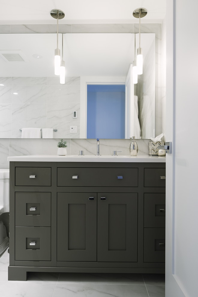 Mid-sized transitional master black and white tile and porcelain tile porcelain tile bathroom photo in Vancouver with shaker cabinets, gray cabinets, white walls, quartz countertops and an undermount sink