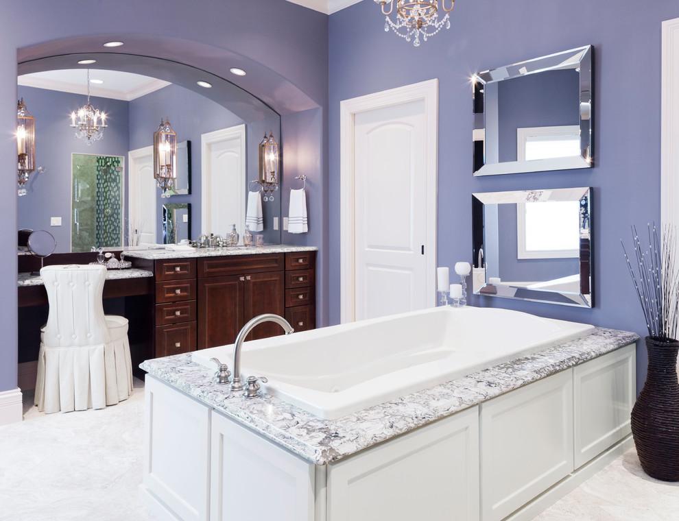 Drop-in bathtub - traditional drop-in bathtub idea in Minneapolis with purple walls