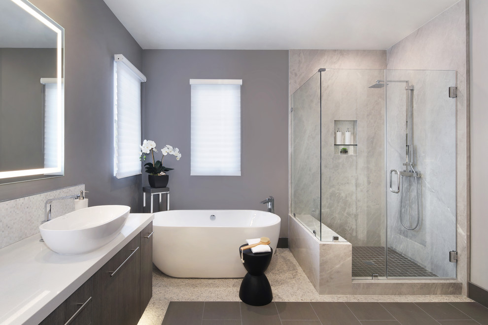 Inspiration for a mid-sized modern master gray tile and stone slab porcelain tile and gray floor bathroom remodel with flat-panel cabinets, dark wood cabinets, gray walls, a vessel sink, quartz countertops, a hinged shower door and white countertops