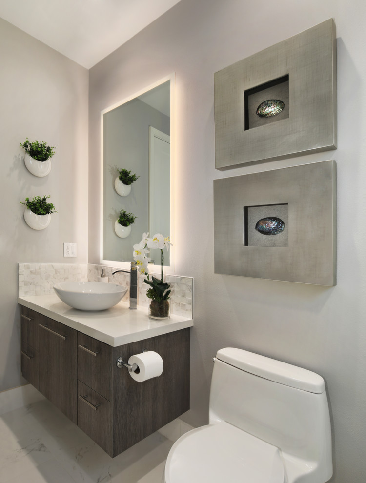 Small minimalist 3/4 white tile and porcelain tile porcelain tile and white floor alcove shower photo in Orange County with flat-panel cabinets, dark wood cabinets, a one-piece toilet, gray walls, a vessel sink, quartz countertops, a hinged shower door and white countertops