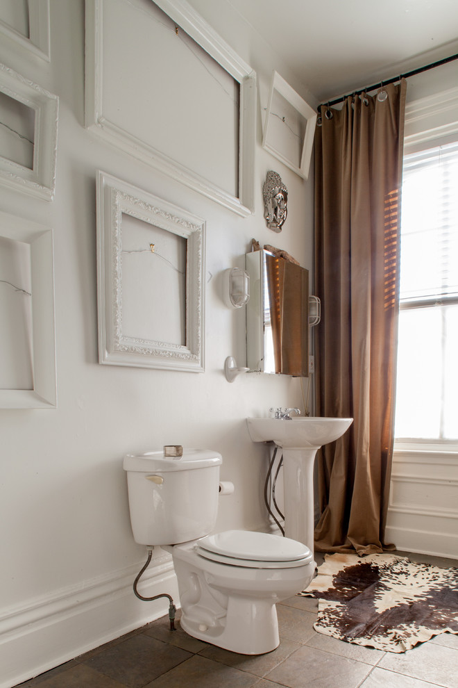 Inspiration for an eclectic brown tile bathroom remodel in Other with a pedestal sink and a two-piece toilet