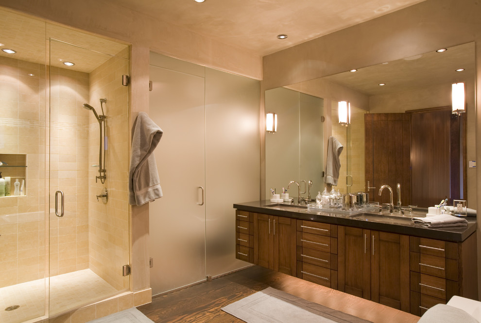 Alcove shower - contemporary beige tile alcove shower idea in Denver with an undermount sink, shaker cabinets and dark wood cabinets