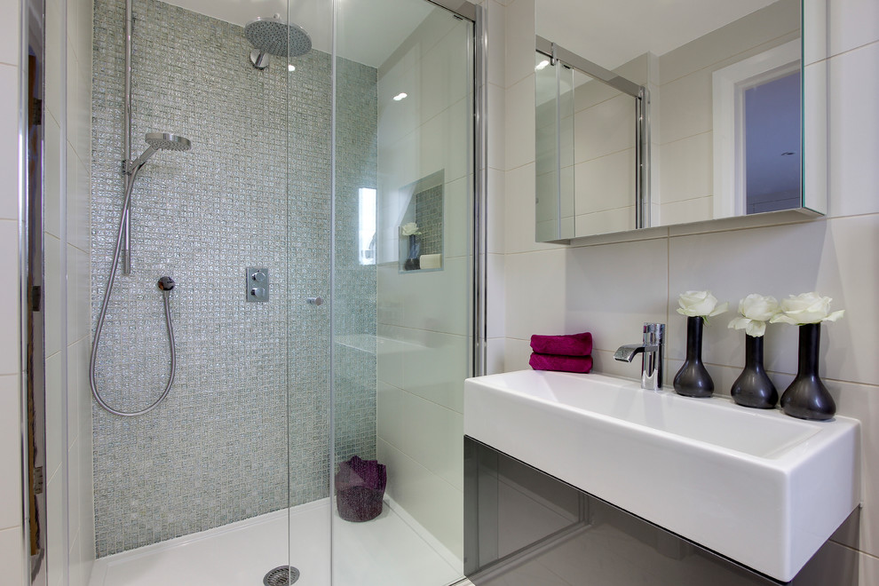 Inspiration for a small contemporary 3/4 mosaic tile porcelain tile walk-in shower remodel in Hertfordshire with flat-panel cabinets, gray cabinets, white walls and a wall-mount sink