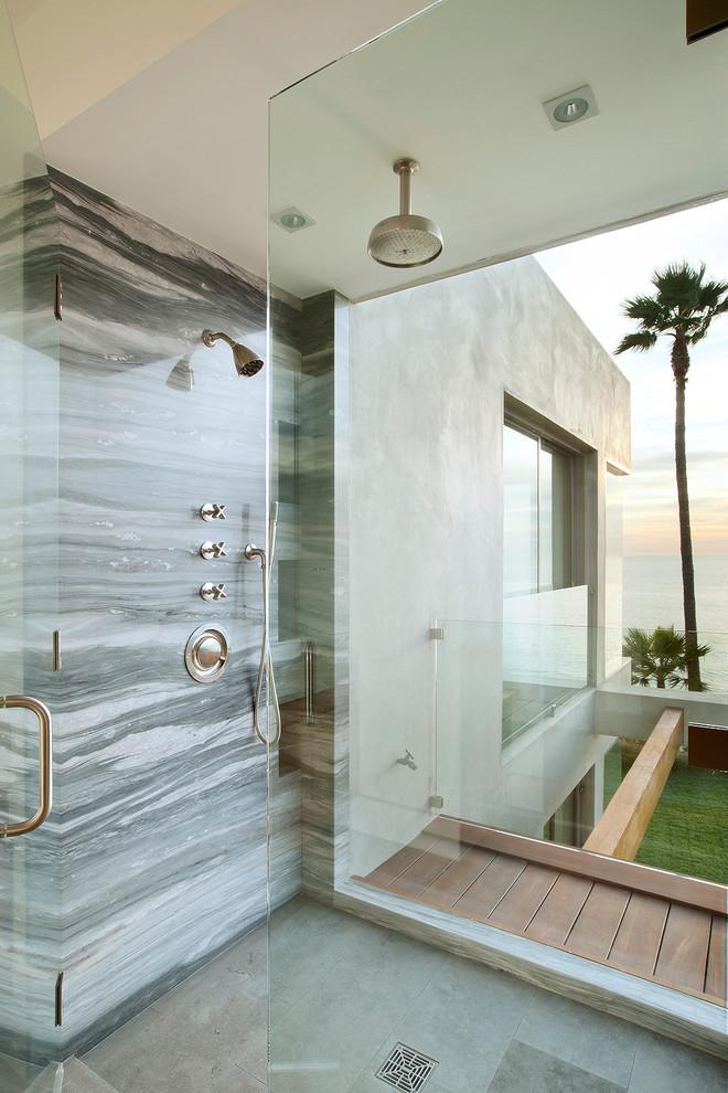 Bathroom - coastal gray tile and stone slab bathroom idea in Los Angeles with a hinged shower door