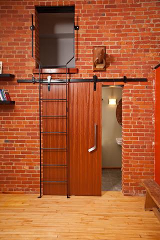 New York style loft with black flat track barn door ...