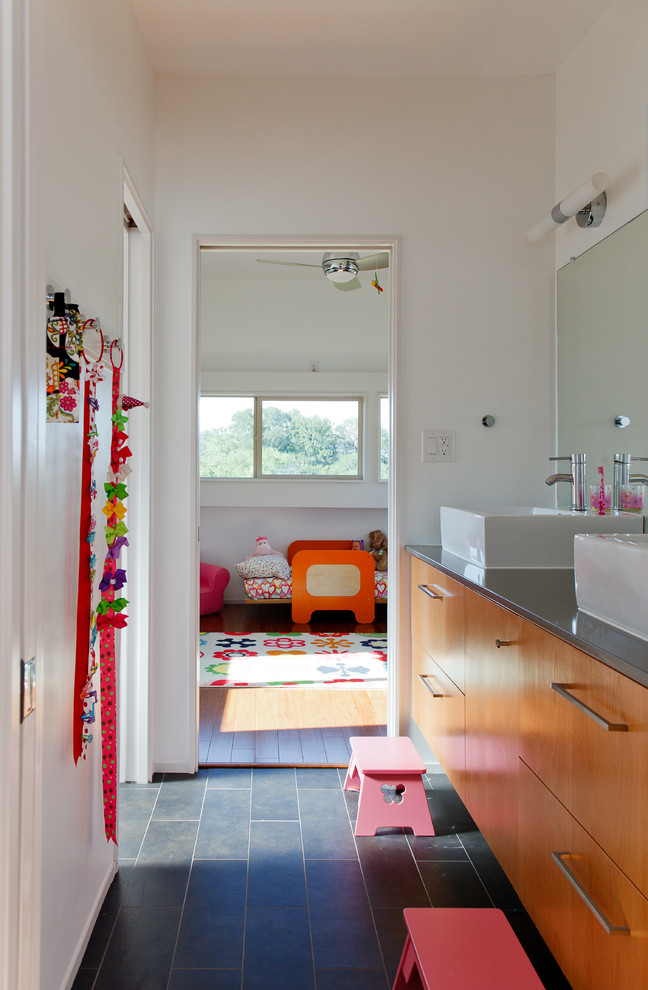 Inspiration for a modern bathroom remodel in Austin with a vessel sink