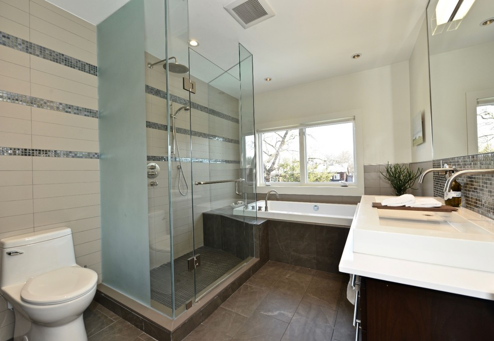 Example of a large trendy white tile and porcelain tile porcelain tile and brown floor bathroom design in Toronto with furniture-like cabinets, brown cabinets, a one-piece toilet, white walls, a vessel sink, solid surface countertops, a hinged shower door and white countertops