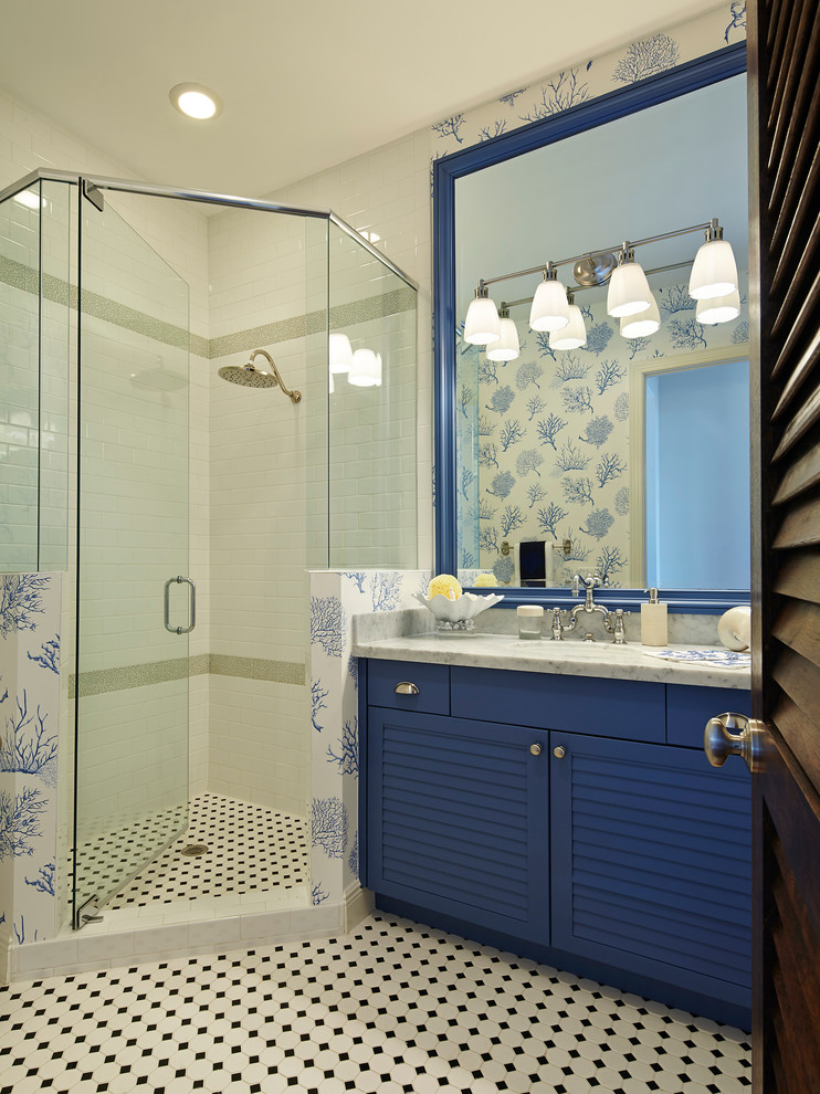 Inspiration for a coastal corner shower remodel in Miami with louvered cabinets and blue cabinets