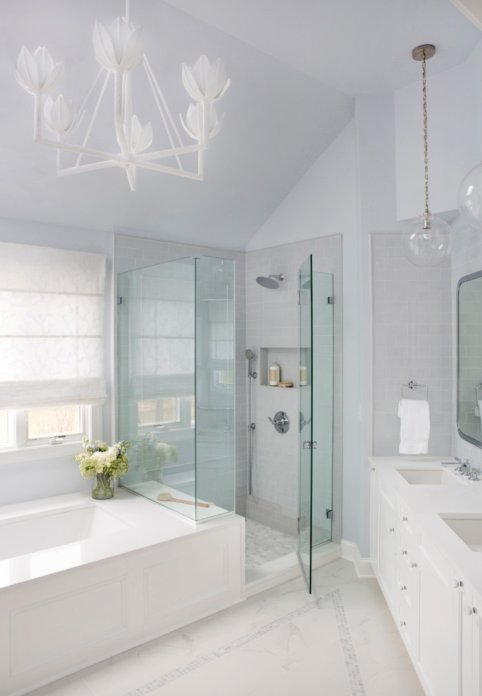 Example of a large transitional master blue tile and ceramic tile porcelain tile, gray floor, double-sink and vaulted ceiling bathroom design in Philadelphia with shaker cabinets, white cabinets, an undermount tub, a two-piece toilet, blue walls, an undermount sink, quartz countertops, a hinged shower door, white countertops and a built-in vanity
