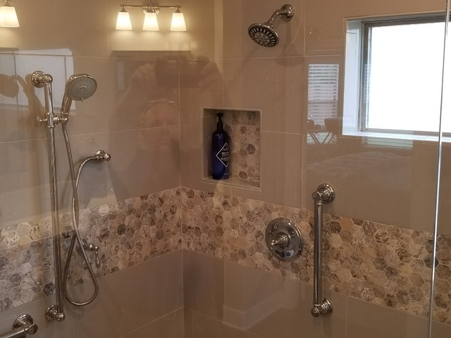 Example of a mid-sized transitional master gray tile and porcelain tile porcelain floor and gray floor bathroom design in Austin with raised-panel cabinets, dark wood cabinets, a two-piece toilet, gray walls, an undermount sink, engineered quartz countertops, a hinged shower door and white countertops