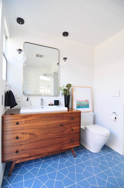 Inspiration for a midcentury modern master white tile and ceramic tile ceramic floor and blue floor bathroom remodel in San Francisco with white walls, furniture-like cabinets, medium tone wood cabinets, a one-piece toilet, a drop-in sink, wood countertops and brown countertops