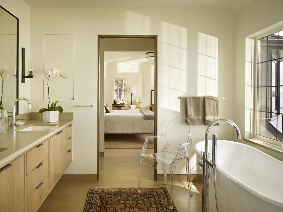 Trendy freestanding bathtub photo in Seattle with an undermount sink