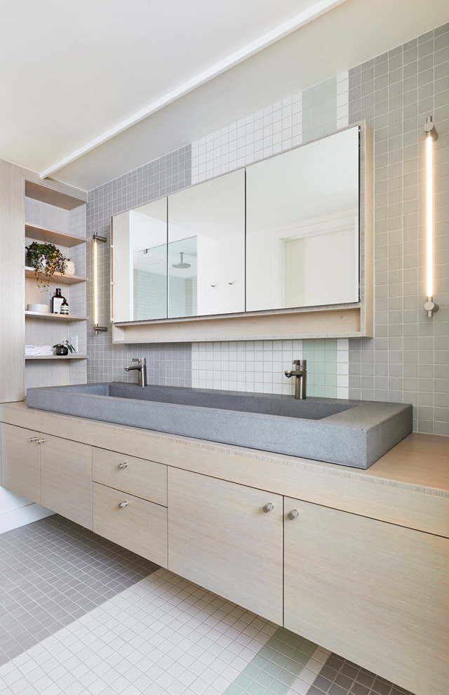 Bathroom - mid-sized contemporary master multicolored tile and mosaic tile mosaic tile floor and multicolored floor bathroom idea in Portland with flat-panel cabinets, light wood cabinets, a trough sink, wood countertops and beige countertops