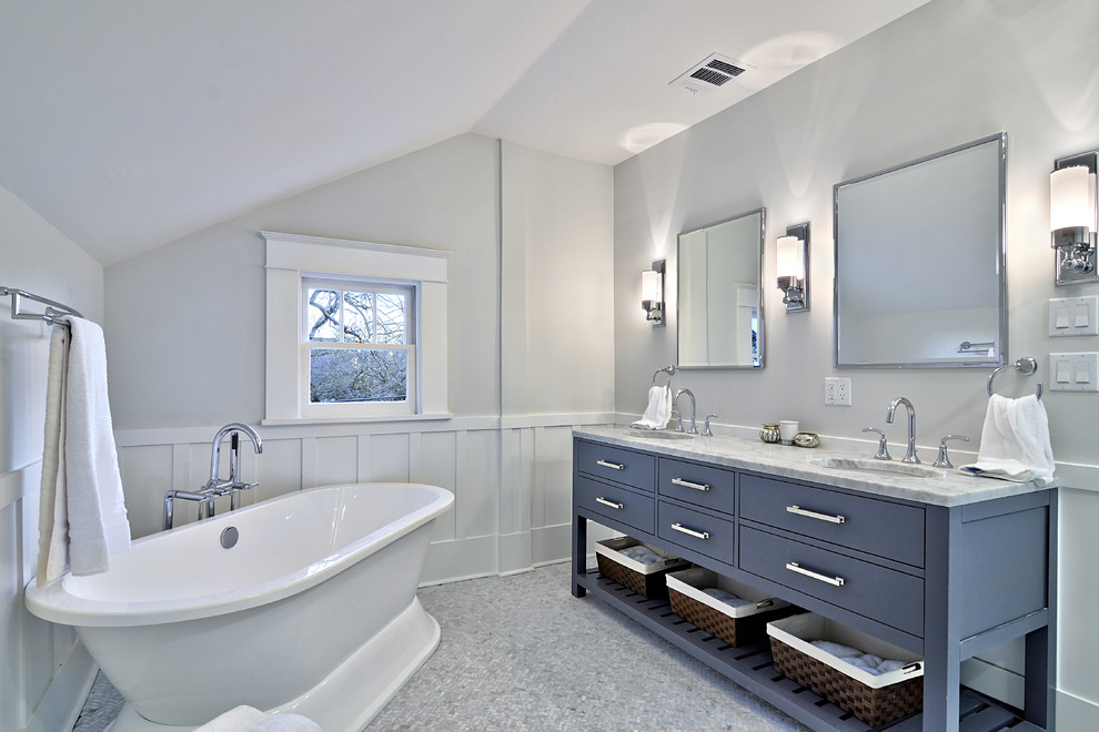 Freestanding bathtub - mid-sized traditional master gray tile freestanding bathtub idea in Austin with marble countertops, blue cabinets and flat-panel cabinets