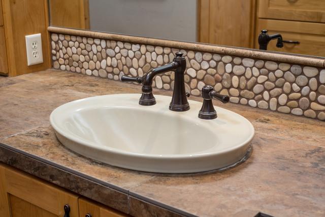 Brasada ranch home master bath rustic bathroom other for Ranch style bathroom ideas