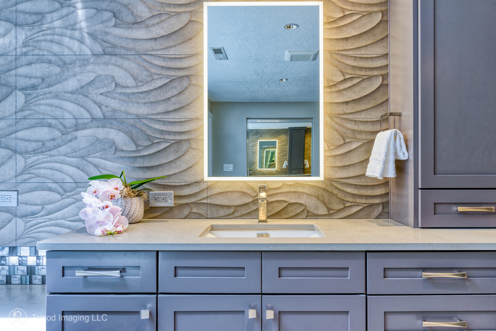 Example of a transitional master bathroom design in Portland with shaker cabinets and a built-in vanity