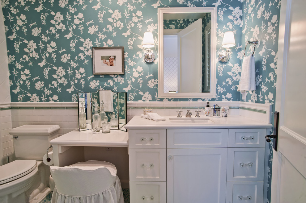 Inspiration for a timeless bathroom remodel in Los Angeles with recessed-panel cabinets, white cabinets, a two-piece toilet and white countertops