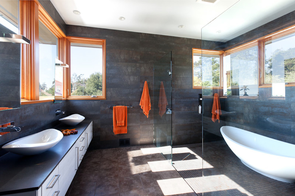 Example of a trendy walk-in shower design in San Francisco with a vessel sink