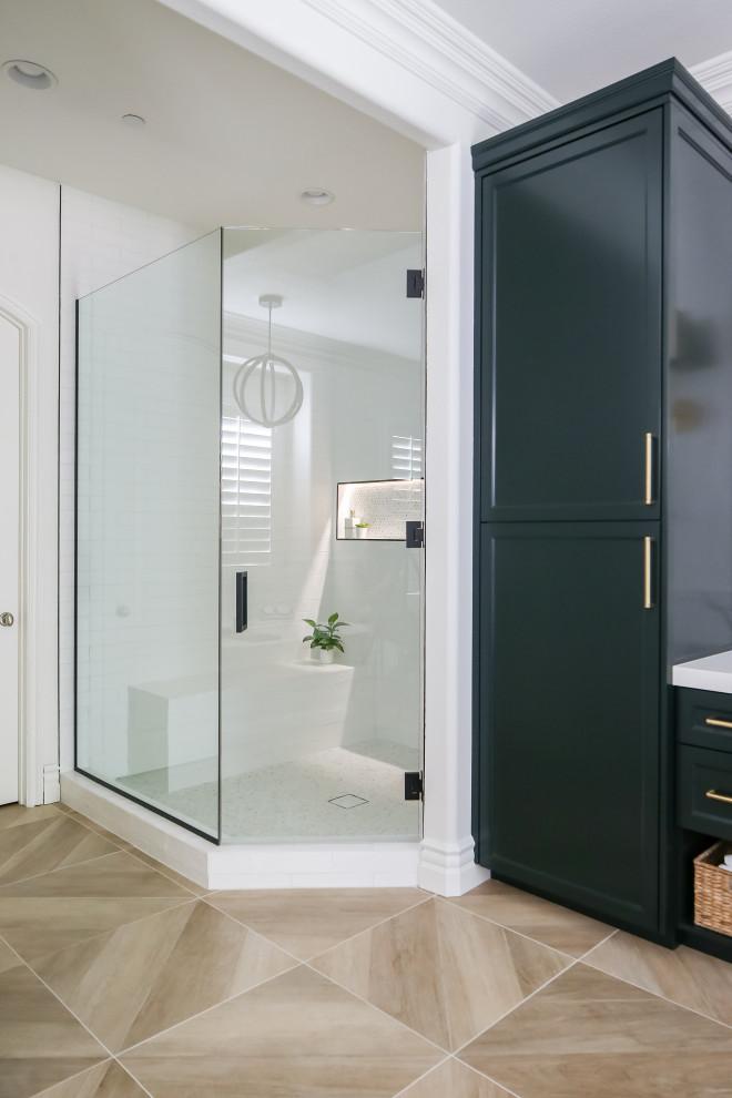 Corner shower - corner shower idea in Orange County with green cabinets
