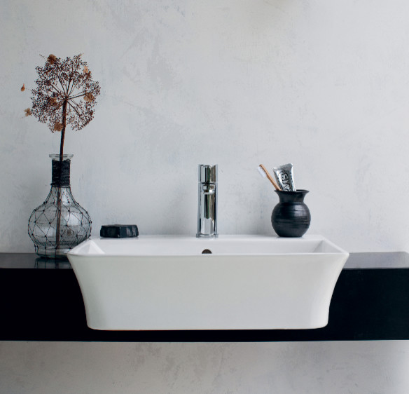 Medium sized contemporary family bathroom in Cambridgeshire with flat-panel cabinets, white cabinets, a built-in bath, a built-in shower, a one-piece toilet, grey tiles, porcelain tiles, grey walls, marble flooring and a pedestal sink.