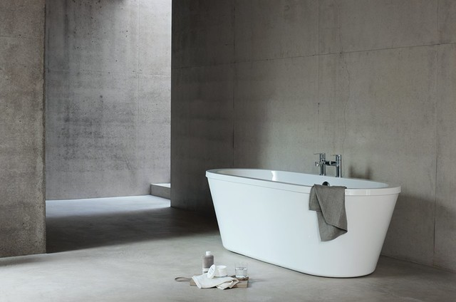 This is an example of a medium sized contemporary family bathroom in Cambridgeshire with flat-panel cabinets, white cabinets, a built-in bath, a built-in shower, a one-piece toilet, grey tiles, porcelain tiles, grey walls, marble flooring and a pedestal sink.