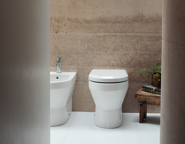 Photo of a medium sized contemporary family bathroom in Cambridgeshire with flat-panel cabinets, white cabinets, a built-in bath, a built-in shower, a one-piece toilet, grey tiles, porcelain tiles, grey walls, marble flooring and a pedestal sink.