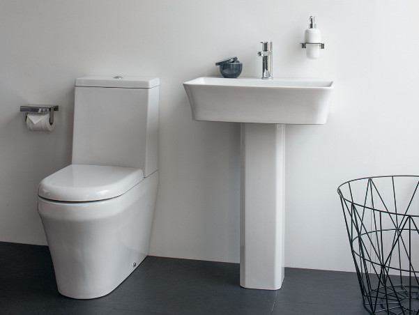 Design ideas for a medium sized contemporary family bathroom in Cambridgeshire with flat-panel cabinets, white cabinets, a built-in bath, a built-in shower, a one-piece toilet, grey tiles, porcelain tiles, grey walls, marble flooring and a pedestal sink.