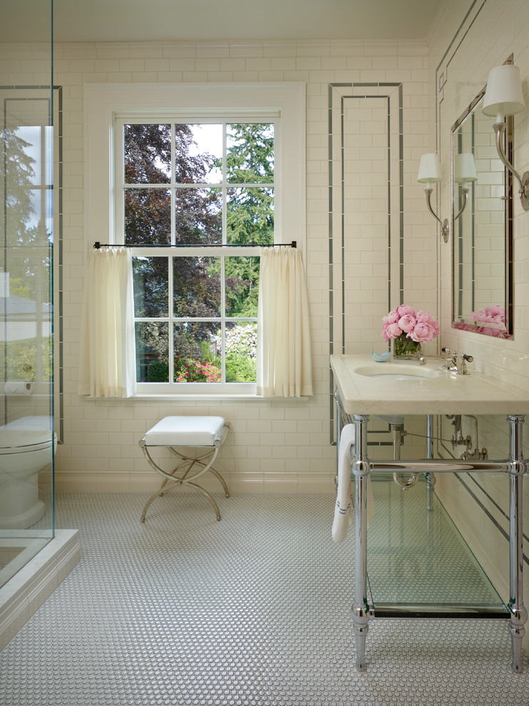 Example of a cottage chic mosaic tile floor bathroom design in Seattle with a console sink