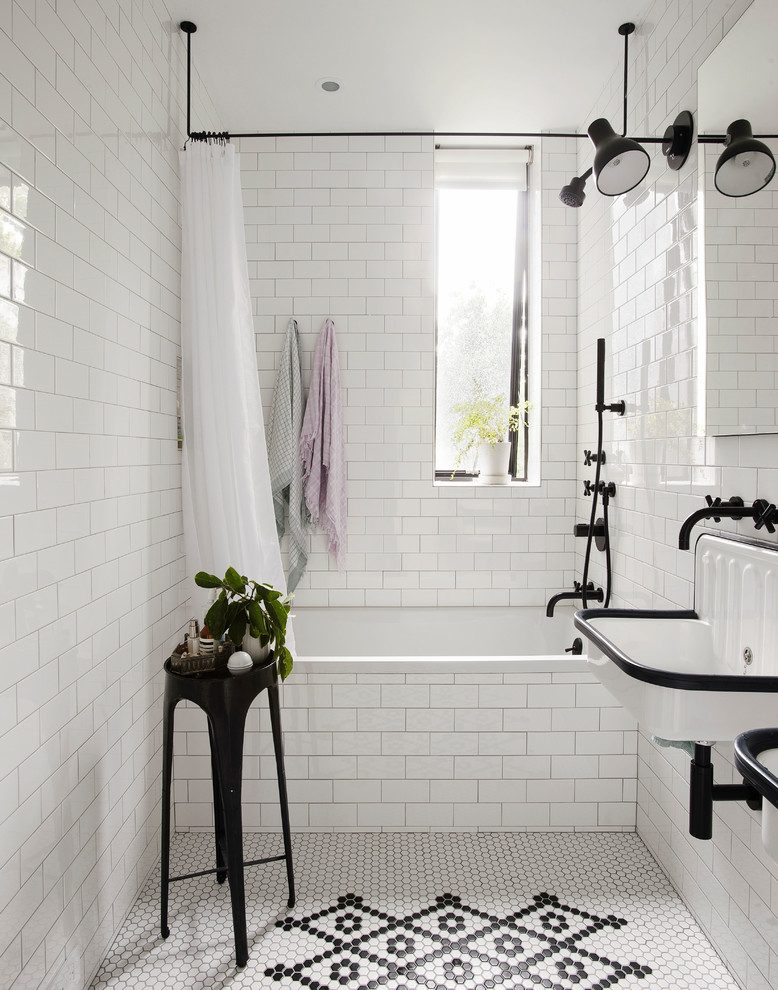 Inspiration for a transitional white tile and subway tile multicolored floor bathroom remodel in New York with a wall-mount sink